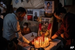 Journalists light candles and pay tribute to Reuters photographer Danish Siddiqui in New Delhi, India, July 17, 2021. The Pulitzer Prize-winning photographer was killed as he chronicled fighting between Afghan forces and the Taliban.