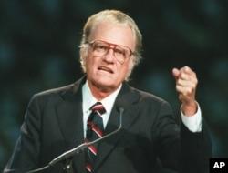 FILE - Evangelist Billy Graham begins his sermon in Atlanta's Georgia Dome, Oct. 26, 1994.