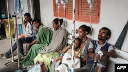 FILE - People who were injured in a deadly airstrike on a market in Togoga wait on a bench for medical treatments at Mekelle General Hospital in Mekelle, June 24, 2021.