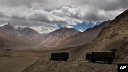 FILE PHOTO: Indian army trucks drive near Pangong Tso lake near the India-China border, Sept. 14, 2017, in India's Ladakh region. (AP Images)