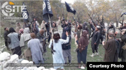 FILE - Fighters with IS-Khorasan, the affiliate in Afghanistan, vow allegiance to new Islamic State leader Abu Ibrahim al-Hashimi al-Qurashi, in this photo issued Nov. 5, 2019, by SITE Intelligence Group.