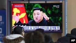 People watch a TV screen showing an image of North Korean leader Kim Jong Un during a news program at the Seoul Railway Station in Seoul, South Korea, Dec. 29, 2019.