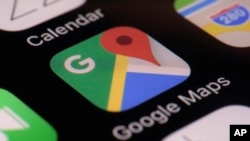 FILE - The Google Maps app is seen on a smartphone, in New York, March 22, 2017.