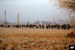 Migrants walk to reach Pazarakule border gate, Edirne, Turkey, at the Turkish-Greek border on March 1, 2020.