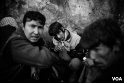 Mohammed Reza, a homeless drug user, smoking methamphetamine under the bridge in Pul e Sukhta area in Kabul. (Maciej Stanik/VOA)