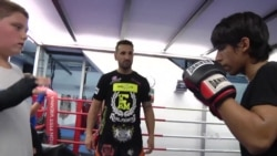 Kickboxing Champion Gives Young Migrants Hope