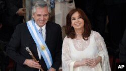 Argentina's new President Alberto Fernandez and Vice President Cristina Fernandez de Kirchner smile after they take the oath of office at the Congress in Buenos Aires, Argentina, Dec. 10, 2019.