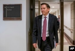 FILE - In this Oct. 4, 2019, photo, Michael Atkinson, the inspector general of the intelligence community, arrives at the Capitol in Washington for closed-door questioning about a whistleblower complaint.