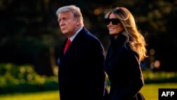President Donald Trump and First Lady Melania Trump walk towards Marine One as they depart the White House en route to Mar-a-Lago, the President's private club, where they will spend Christmas and New Years Eve in Washington, DC on December 23, 2020…