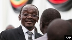 FILE PHOTO - On Dec. 28, 2017, Zimbabwe's newly appointed vice president Kembo Mohadi reacts as he looks on during the swearing-in ceremony in Harare.