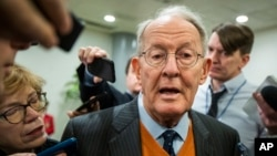Sen. Lamar Alexander, R-Tenn., speaks to reporters as he arrives at the Capitol in Washington, Monday, Jan. 27, 2020, during the impeachment trial of President Donald Trump on charges of abuse of power and obstruction of Congress. (AP Photo/Manuel…