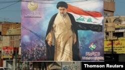 ဘက္ဒက္ၿမိဳ႕မွာ ေရြးေကာက္ပဲြ မဲဆြယ္ဖို႔အတြက္ ေထာင္ထားတဲ့ Shiite (ရွီအာ)မြတ္စလင္ေခါင္းေဆာင္ Moqtada al-Sadr ႐ုပ္ပံု