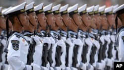 Soldiers from China's People's Liberation Army (PLA) Navy march in formation during a parade to commemorate the 70th anniversary of the founding of Communist China in Beijing, Tuesday, Oct. 1, 2019. Trucks carrying weapons including a nuclear-armed…