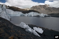 """The retreating ice of the Pastoruri glacier is seen in the Huascaran National Park in Huaraz, Peru, Aug. 12, 2016. The melting of glaciers has put cities like Huaraz at risk of what scientists call a """"glof,"""" or glacial lake outburst flood."""