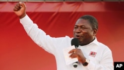 In this photo taken Saturday, Oct. 12, 2019, ruling Frelimo Party leader and President Filipe Nyusi, at an election rally in Maputo, Mozambique. The country's elections on Tuesday, Oct 15, 2019 are almost certain to return the ruling party, Frelimo,…