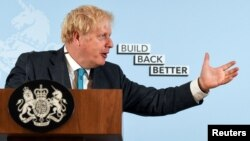 British Prime Minister Boris Johnson delivers a speech at Exeter College Construction Centre, part of Exeter College in Exeter, Britain, Sept. 29, 2020.