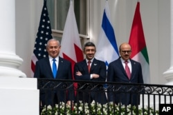 Israeli Prime Minister Benjamin Netanyahu, left, UAE Foreign Minister Abdullah bin Zayed al-Nahyan, and Bahrain Foreign Minister Khalid bin Ahmed Al Khalifa stand at the White House during the Abraham Accords signing ceremony, Sept. 15, 2020.