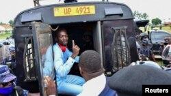 Ugandan presidential candidate Robert Kyagulanyi, also known as Bobi Wine, sits inside a police vehicle in Luuka district, eastern Uganda, Nov. 18, 2020.