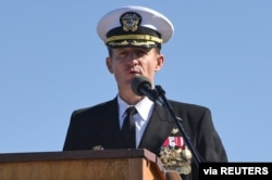 FILE - Captain Brett Crozier addresses the crew for the first time as commanding officer of the aircraft carrier USS Theodore Roosevelt in San Diego, California, March 1, 2020.