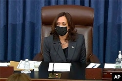 FILE - In this image from Senate TV, Vice President Kamala Harris sits in the chair on the Senate floor to cast her first tie-breaking vote at the Capitol in Washington, Feb. 5, 2021.