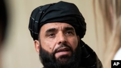 Suhail Shaheen, juru bicara kantor politik Taliban di Doha, berbicara kepada para wartawan di Moskow, Rusia, 28 Mei 2019.