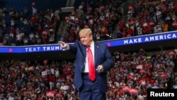 U.S. President Donald Trump points at the crowd as he enters his first re-election campaign rally in several months in the midst of the coronavirus disease (COVID-19) outbreak, at the BOK Center in Tulsa, Oklahoma, June 20, 2020.