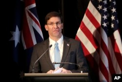 U.S. Defense Secretary Mark Esper briefs the media at a press conference following annual bilateral ministerial talks in Sydney, Australia, Aug. 4, 2019.