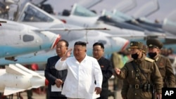 FILE - In this undated file photo provided by the North Korean government on April 12, 2020, North Korean leader Kim Jong Un inspects an air defense unit in western area, North Korea.