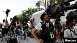 FILE - Journalists wait outside St. Regis Hotel in Singapore, June 11, 2018. ,