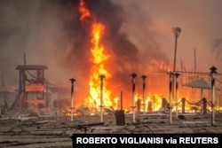 A view of a fire at Le Capannine beach in Catania, Sicily, Italy, July 30, 2021, in this photo obtained from social media. (Credit: Roberto Viglianisi/via Reuters)