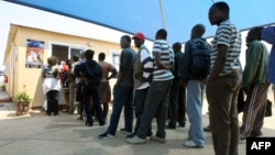 FILE - Zimbabweans deported from Botswana wait at the International Organization for Migration center in Zimbabwe, Sept. 12, 2009. This week, hundreds of Zimbabwean refugees in Botswana were told they must return to their home country.
