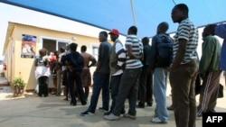 FILE - Zimbabweans deported from Botswana wait at the International Organization for Migration center in Zimbabwe.