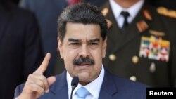 El presidente en disputa de Venezuela, Nicolás Maduro, habla durante una conferencia de prensa en el Palacio de Miraflores en Caracas, Venezuela, el 12 de marzo,de 2020.