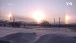 Феномен сонячних «німб» помітили у небі над ранковим містом у Китаї. Відео