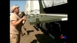2014-08-17 美國之音視頻新聞: 俄羅斯援助車隊停車等待安全檢查