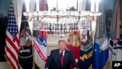 President Donald Trump speaks in the Diplomatic Room of the White House in Washington, Sunday, Oct. 27, 2019, to announce that Islamic State leader Abu Bakr al-Baghdadi has been killed during a US raid in Syria.