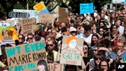 FILE - Activists march on Parliament to protest a lack of action on climate change, in Wellington, New Zealand, Sept. 27, 2019.