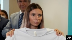Belarusian Olympic sprinter Krystsina Tsimanouskaya, who came to Poland on Wednesday fearing reprisals at home after criticizing her coaches at the Tokyo Games, is shown after her news conference in Warsaw, Poland, on Aug. 5, 2021.
