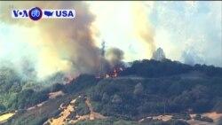 VOA60 America - New Wind-Driven Wildfire Erupts in Southern California