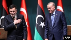 Turkish President Recep Tayyip Erdogan, right, and Libyan Prime Minister Fayez al-Sarraj hold a joint press conference at the Presidential Complex in Ankara on June 4, 2020.