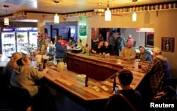 Club Ritz reopens to patrons following the Wisconsin Supreme Court's decision to strike down Governor Tony Evers' safer-at-home order against coronavirus disease (COVID-19) in Kaukana, Wisconsin, May 13, 2020.