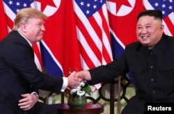FILE - U.S. President Donald Trump and North Korean leader Kim Jong Un shake hands before their one-on-one chat during the second U.S.-North Korea summit at the Metropole Hotel in Hanoi, Vietnam, Feb. 27, 2019.