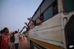 People who fled the conflict in Ethiopia's Tigray region, arrive on a bus at Umm Rakouba refugee camp in Qadarif, eastern Sudan, Nov. 26, 2020.