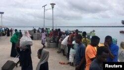 Travellers are seen gathered at the Lamu jetty following an attack by Somalia's Islamist group al Shabaab on a military base in Manda, Lamu, Kenya January 5, 2020. REUTERS/Abdalla Barghash NO RESALES. NO ARCHIVES