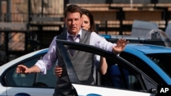 """FILE - Actors Tom Cruise and Hayley Atwell appear during the filming of the movie """"Mission: Impossible 7"""" in Rome on Oct. 13, 2020."""
