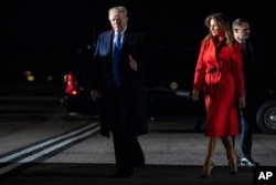 President Donald and first lady Melania Trump arrive at London Stansted Airport to attend the NATO summit, Dec. 2, 2019, in London.