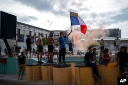 Protesters block a highway during a demonstration in Marseille, southern France, Aug. 7, 2021. Thousands of people marched in Paris and other French cities during a fourth consecutive week of protests against COVID-19 entrance requirements.