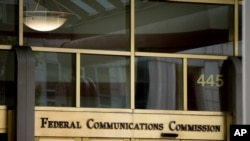 FILE - The entrance to the Federal Communications Commission (FCC) building is seen in Washington, June 19, 2015.
