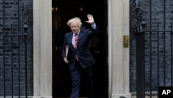 Britain's Prime Minister Boris Johnson leaves 10 Downing Street to attend the weekly session of PMQs in Parliament in London, June 10, 2020.