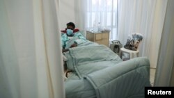 A patient being treated at a makeshift hospital run by charity organisation The Gift of the Givers, during the coronavirus disease (COVID-19) outbreak in Johannesburg, South Africa, July 10, 2021.